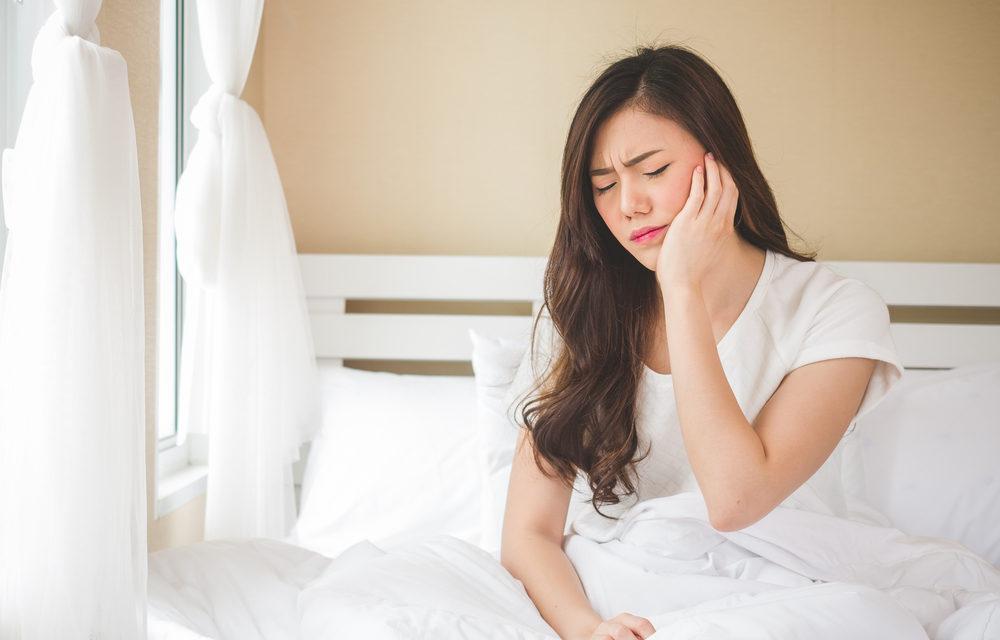 woman experiencing dental pain